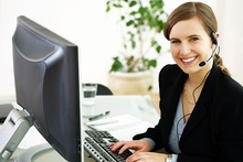 Smiling receptionist in black
